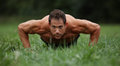 Push ups in the park grass Royalty Free Stock Photo