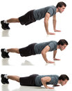 Push ups young adult man doing studio shot over white Stock Photos