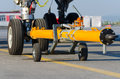 Pushing the plane back the cart on the front landing gear of the chassis Royalty Free Stock Photo