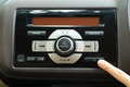 Pushing the power button to turn on the car stereo system 1 Royalty Free Stock Photo