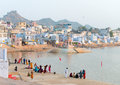 Pushkar india november pilgrims take ritual bathing in holy lake on november in pushkar rajasthan india it is one of the five Royalty Free Stock Photo