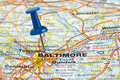 Pushpin in baltimore maryland usa map charm city highlighted with a blue push pin on an atlas or Stock Photography