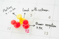 Pushpin on calendar with busy day. Royalty Free Stock Photo