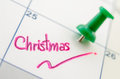 Pushpin on calendar with christmas day Stock Photo