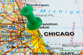 Pushpin in chicago map city of highlighted with a green push pin on an atlas or Stock Image