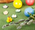 Pussy willow flower branch with easter eggs on green background Stock Photos