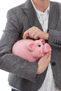 Put coin into piggy bank businesswoman a Royalty Free Stock Photos