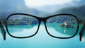 Put the glasses for the different, better view. Looking at the lake with the mountains. Royalty Free Stock Photo