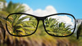 Put the glasses for the different, better view. Looking at the palms, clouds and sky. Royalty Free Stock Photo