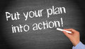 Put your plan into action text in lowercase text written on black chalkboard with female hand holding the chalk Stock Image