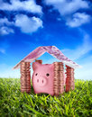 Put your savings safe piggybank in the home of under the serenity sky Stock Photo