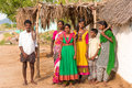 PUTTAPARTHI, ANDHRA PRADESH, INDIA - JULY 9, 2017: Indian family near the house. Copy space for text. Royalty Free Stock Photo