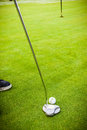 Putter hit a golf player aiming for the hole on the green with a Stock Photography