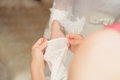 Putting on glove bridesmaid helping to put Stock Image