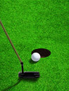 Putting Golf Ball Close to Hole With Copy Space Royalty Free Stock Photo