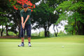 Putting golf teenager boy player green Royalty Free Stock Photos