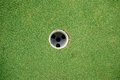 Putting green golf hole top shot without ball Stock Photo