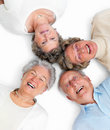 Putting heads together - old people concept Stock Images