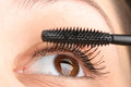 Putting mascara Royalty Free Stock Images