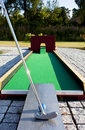 Putting at a mini golf leisure facility. Stock Photo