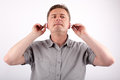Putting on portrait of a middle aged man his hearing aids Stock Images