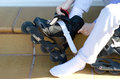 Putting on roller blades Royalty Free Stock Photo