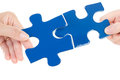 Putting two pieces of jigsaw together people Royalty Free Stock Photo