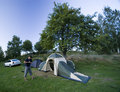 Putting up tent. Royalty Free Stock Image