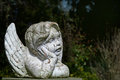 Putto or child angel statue of ceramic with flaking white paint Royalty Free Stock Photo