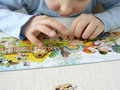 Puzzle assembling 1 Royalty Free Stock Images