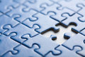 Puzzle background with one piece missing Royalty Free Stock Photo