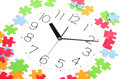 Puzzle and clock face Stock Photos