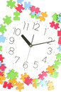 Puzzle and clock face Stock Image