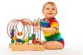 Puzzle developing toy little toddler playing with sitting isolated on white Royalty Free Stock Photo