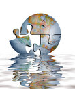 Puzzle Of Earth Globe In Water Stock Image