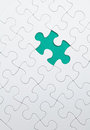 Puzzle with green piece missed Stock Photography