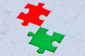 Puzzle with a green and red gap jigsaw Stock Photo