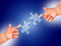 Puzzle and hands over blue background Royalty Free Stock Image