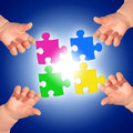 Puzzle and hands over blue background Royalty Free Stock Images
