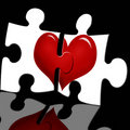 Puzzle with heart on black background Stock Photography