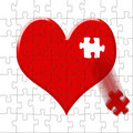 Puzzle-heart with the lost slice Stock Photo
