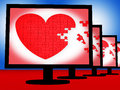 Puzzle heart on monitors shows love and marriage Royalty Free Stock Photo