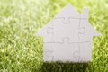 Puzzle house on grass Royalty Free Stock Photo