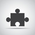 Puzzle icon with shadow on a gray background. Vector illustration