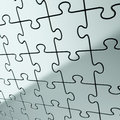 Puzzle jigsaw background made of shiny metal pieces Royalty Free Stock Photos