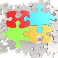 Puzzle jigsaw four color Royalty Free Stock Photo