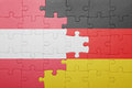 Puzzle with the national flag of austria and germany