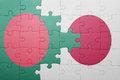 Puzzle with the national flag of bangladesh and japan