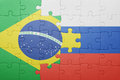 Puzzle with the national flag of brazil and russia