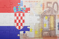 Puzzle with the national flag of croatia and euro banknote Royalty Free Stock Photo
